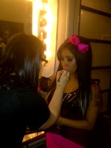 Touching up Snooki's makeup