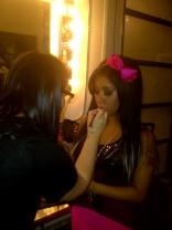 Touching up Snooki's makeup